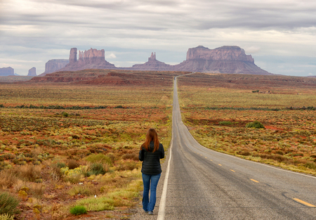 47349232 - lost and wandering in monument valley while walking down road in the old west