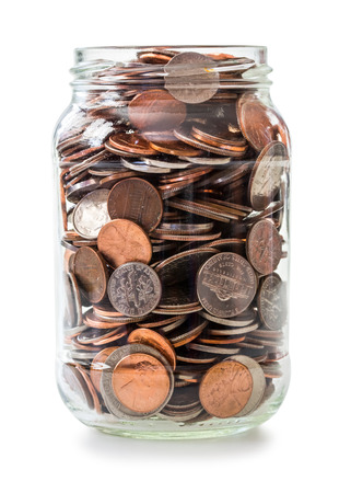 39222180 - jar full of coins isolated on white