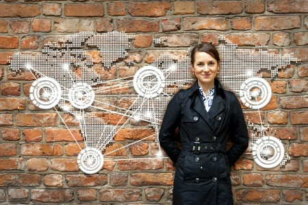 15235644 - woman by the wall with world map travel